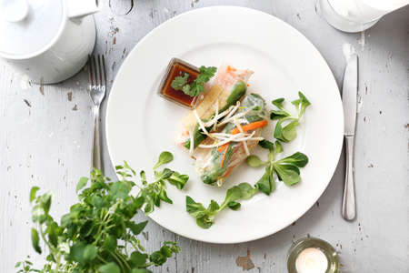 Vegetarian sprout rollsy with vegetables, carrots, radishes, tofu, mung bean sprouts in rice paper. Horizontal frame, top view 스톡 콘텐츠