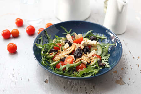 A plate of appetizing healthy, vegetarian lettuce on a white table. horizontal Reklamní fotografie