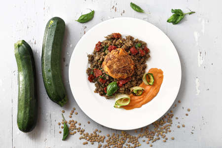 Lentils, carrot puree and grilled zucchini, vegetarian lunch. Horizontal frame. Top view. Reklamní fotografie