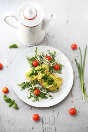 Appetizing sandwiches with egg paste and chives served with salad and tomatoes. Vertical frame, top view