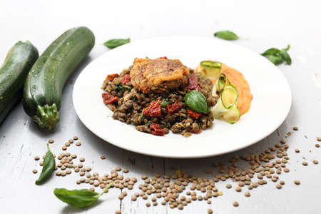 Lentils, carrot puree and grilled zucchini, vegetarian lunch. Horizontal frame.