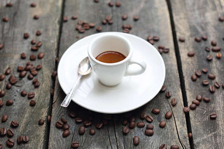 Coffee in a cup on a wooden background Archivio Fotografico - 133481242