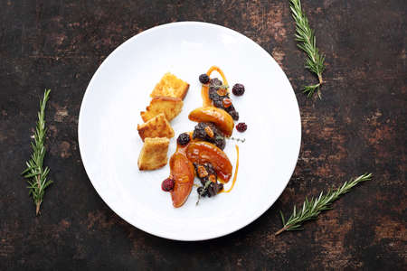Fried chicken liver with raspberry and blackberry fruit served with caramelized apple and croutons