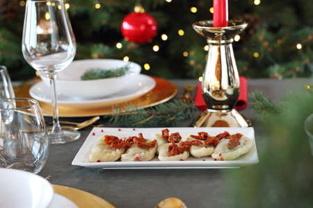 Dumplings with cabbage and mushrooms. Christmas dinner
