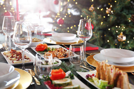 Festive dishes on an elegant table. Christmas dishes, festive table setting. Horizontal composition.