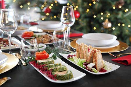 Christmas table. Traditional and tasty Christmas dishes. Christmas dishes, festive table setting. Horizontal composition.