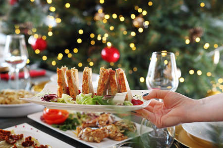 Fish pate, gourmet snack on the holiday table. Christmas dishes, festive table setting. Horizontal composition.