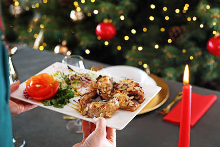 Carp in almonds, Christmas dish. Traditional Christmas dishes, festive table setting. Horizontal composition.