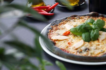 Pizza on black dough. Black pizza.Black food. Reklamní fotografie