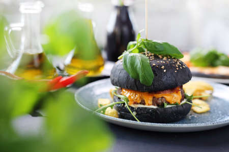 Cheeseburger in a black roll. Classic burger
