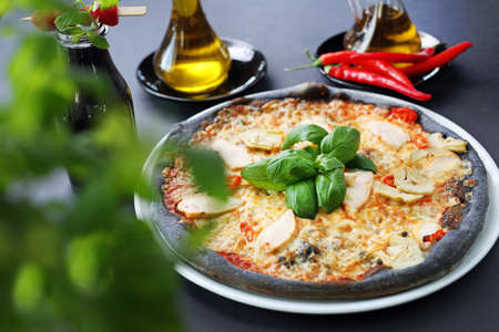 Black pizza, tasty pizza on black dough.