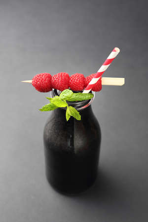 Black lemonade, a healthy drink with activated carbon with raspberries and myth.