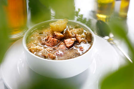 White borscht with sausage and potatoes. Traditional Polish sour rye soup with sausage and potatoes. Appetizing soup. Suggestion to serve the dish. Culinary photography.