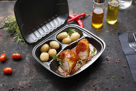 Takeaway food in a box. Ready prepared meal in a box. Tasty catering delivered to the office.