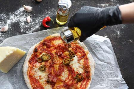 Peperoni pizza with tomato sauce, mozzarella cheese. Culinary photography. Stock fotó