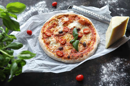 Classic margherita pizza. Pizza with tomato sauce and mozzarella cheese with black olives and basil. Stock fotó