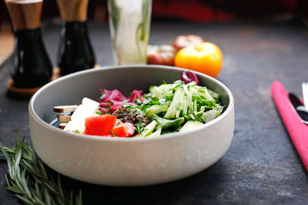 Vegetable diet. Fresh vegetable salad, colorful healthy diet. Food served on a plate, food styling, serving suggestions, culinary photography.