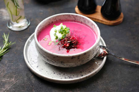 Beetroot soup with cream and chives. Food served on a plate, food styling, serving suggestions, culinary photography. Stock fotó