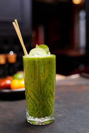 Green smoothie of kiwi, spinach and celery. A refreshing healthy green fruit and vegetable smoothie. Stock fotó