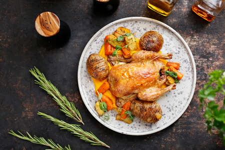 Roast duck with hasselback potatoes and vegetables. Culinary photography. Suggestion to serve the dish.