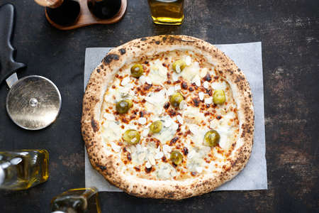 Pizza with gorgonzola cheese, brussels sprouts and roasted almonds. Culinary photography. Proposal for dishes.