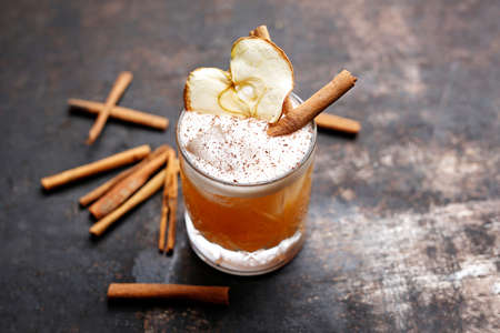 Apple and cinnamon cocktail. Culinary photography.