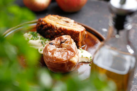 Pork ribs baked with apples served on a plate. Culinary photography. Suggestion to serve the dish. 版權商用圖片