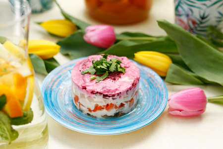 Herring salad with beetroots. Traditional dish. A colorful appetizing dish. Culinary photography, food styling.