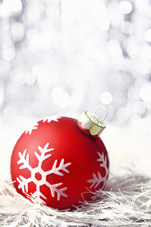 red christmas bauble with snowflake and bokeh photo