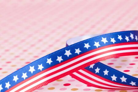 combines: american flag bow on a dotted background Stock Photo