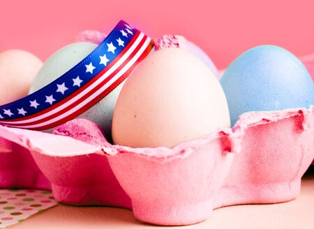 easter eggs in a box with an american bow photo