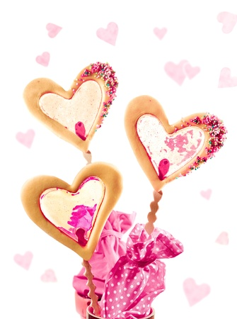 happy love: three cookies on a stick with caramell filling maybe for valentine as a card Stock Photo