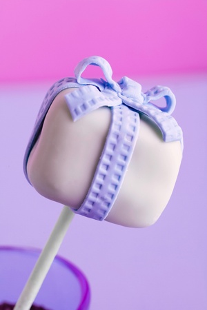 cake pops: a purple cakepop with a bow