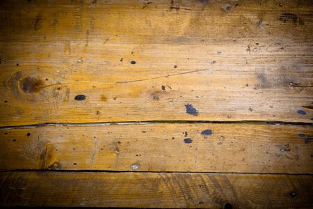 oiled: Background of old wooden boards with grain, texture, cracks and stains.