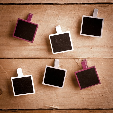Six Squary Polaroid-style photo frames on a wooden background