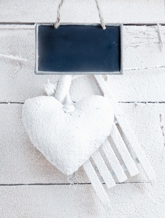 Romantic checked snowy heart for Valentines hanging on snow white boards with tag Stock Photo - 12301299