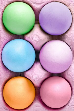 Farbe: colored easter eggs in a box as a close up
