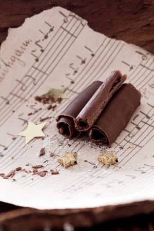 chocolate curls with golden stars and music paper photo