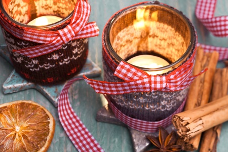 easing: Chrismas light with red white bow and dried fruits Stock Photo