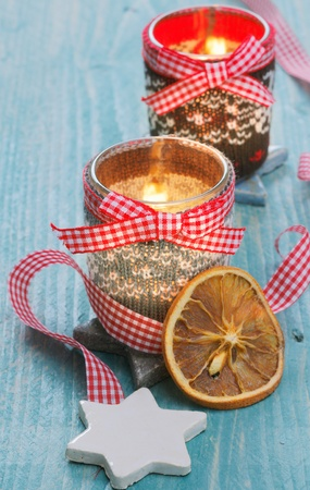 bracing: christmas light with dried fruits and a red-white bow Stock Photo