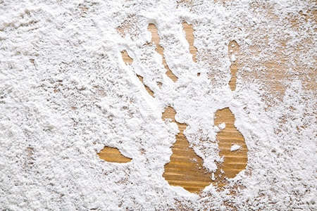 Flour Artwork With Food And Handprints. Fun Background with human handprint photo