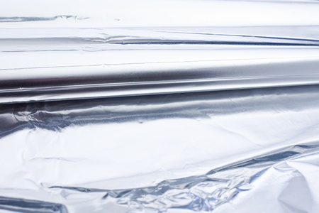 aluminium foil roll as a closeup. Smooth Structure. tin foil. photo