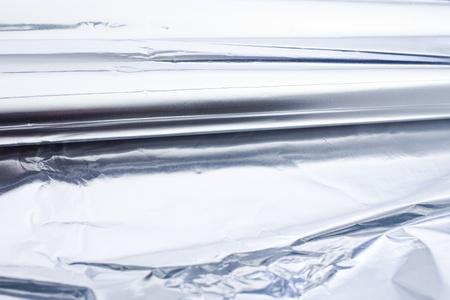 foil roll: aluminium foil roll as a closeup. Smooth Structure. tin foil. Stock Photo