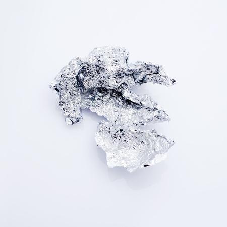 foil roll: Tinfoil Ball Isolated on White, damaged aluminium foil.