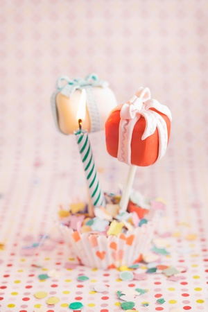 maybe: Cake pops as a gift with a candle, for celebration or maybe for valentine Stock Photo