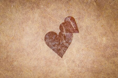 vignetting: Vintage textured paper with heart and corner vignetting, blank for valentines message, copyspace.
