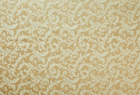 brocade: Abstract background of a heavy beige brocade fabric with interwoven repeat design.