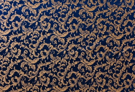 Abstract background of a heavy deep blue brocade fabric with interwoven repeat design. photo
