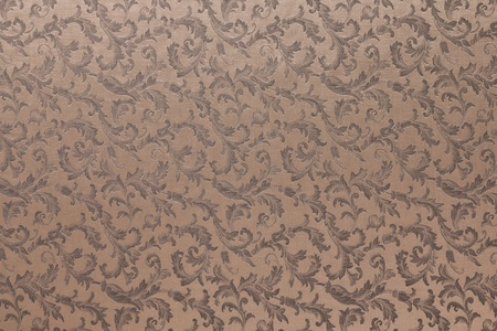 brocade: Abstract background of a heavy brown brocade fabric with interwoven repeat design.