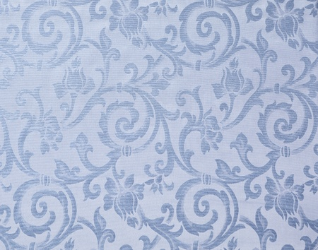 Abstract background of a heavy light blue brocade fabric with interwoven repeat design. photo